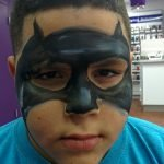 Batman face painting on a kid